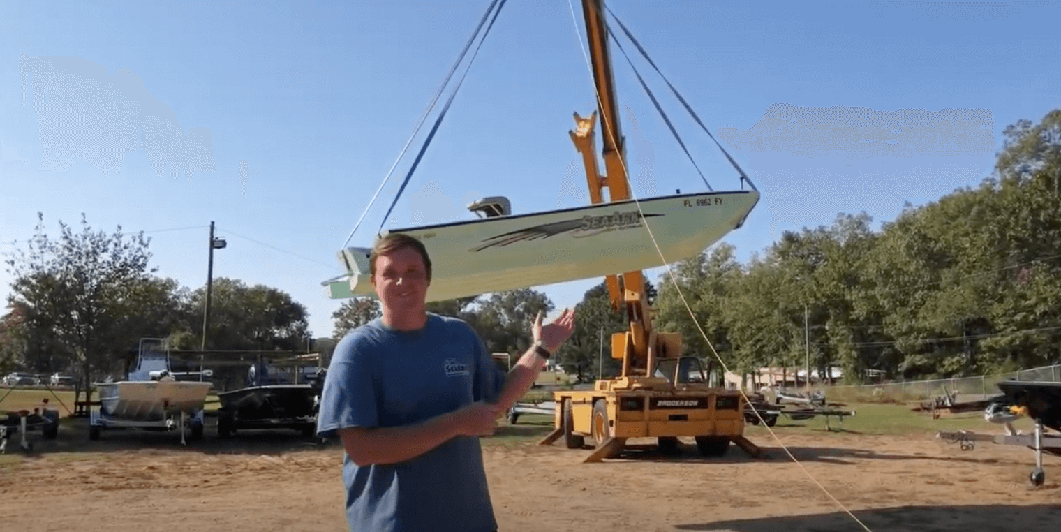 Jeremy Coe standing in front of a SeaArk boat before it is being dropped from a crane for a strength test. seaark boat SeaArk Boats – How tough is a SeaArk? Well we dropped ours from a crane to show you! Screen Shot 2021 05 28 at 9